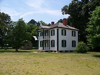 Battle of Bentonville - The Harper House, built in the 1850s, served as a Union field hospital during the battle and is located adjacent to the Bentonville Battlefield museum, which offers tours of its interior.