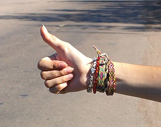 A typical hitchhiker's thumb gesture Hitchhiker's gesture.jpg