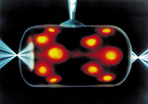 Inertial confinement fusion - Indirect drive laser ICF uses a hohlraum which is irradiated with laser beam cones from either side on its inner surface to bathe a fusion microcapsule inside with smooth high intensity X-rays. The highest energy X-rays can be seen leaking through the hohlraum, represented here in orange/red.