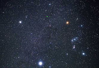 Sirius - Sirius (bottom) and the Orion constellation (right). Together, the three brightest stars of the northern winter sky—Sirius, Betelgeuse (top right), and Procyon (top left)—can also be understood as forming the Winter Triangle.