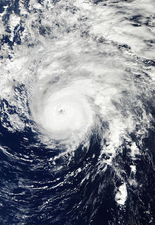 A satellite image depicting a well-developed hurricane with a clear eye visible.