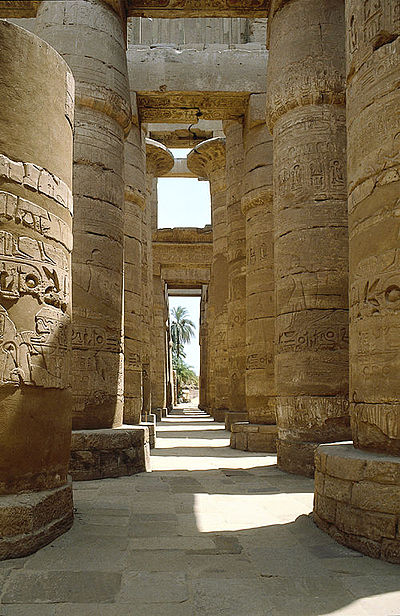 The hypostyle hall of Karnak Temple. Pictured here is the largest of the precincts of the temple complex, and is dedicated to Amun-Re. The material of these columns is sandstone. Hypostyle hall, Karnak temple.jpg