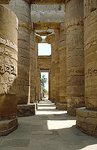 Karnak temple's hypostyle halls are constructed with rows of thick columns supporting the roof beams.