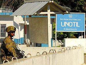 ISF soldier provides security to UNOTIL compound.jpg