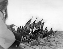 1911 photograph of Ibn Saud's Ikhwan forces, which initially fulfilled the role that would later be taken over by both the Military of Saudi Arabia and the Saudi Public Security Forces.