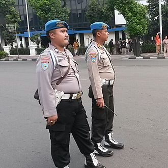 Provost (military police) - Two Indonesian Police provosts monitoring police personnel in Jakarta