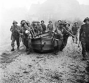 Assault boat - British soldiers crossing the Meuse-Escaut canal