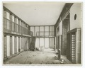 Interior work - construction of bookcases at floor level and on a balcony (NYPL b11524053-489676).tiff