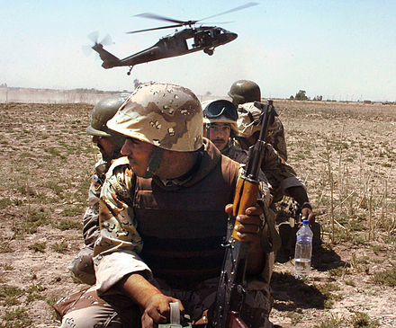 An Iraqi Army unit prepares to board a Task Force Baghdad UH-60 Blackhawk helicopter for a counterinsurgency mission in Baghdad in 2007. Iraqi soldiers and Blackhawk.jpg