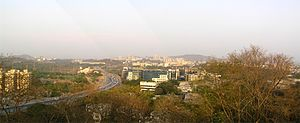 Jogeshwari–Vikhroli Link Road - The JVLR as seen from the top of the Mahakali Caves in Andheri (East). The Powai and SEEPZ skylines are also visible.