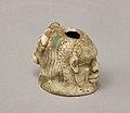 Janus-faced aryballos depicting a Nubian and a bull MET 2008.546 top.jpeg