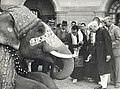Jawaharlal Nehru, Dalai Lama and Panchan Lama with an elephant at Rashtrapati Bhavan, New Delhi, December 1956.jpg