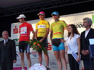 Fränk Schleck - Schleck on the podium as wearer of the mountains jersey after Stage 1 of the 2006 3-Länder-Tour in Kassel, with Patrik Sinkewitz (centre) and Christian Knees (right).