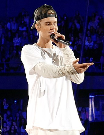 "Canadian singer Justin Bieber has been referred to as the ""Prince of Pop"" and ""King of Teen Pop"". Justin Bieber in Rosemont, Illinois (2015).jpg"