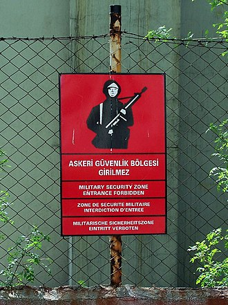 Bilingual sign - Warning sign at the fence of the military area in Turkey, in Turkish, English, French and German.