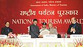 K. Chiranjeevi presenting a memento to the President, Shri Pranab Mukherjee, at the presentation ceremony of the National Tourism Awards 2011-12, in New Delhi. The Tourism Secretary, Shri Parvez Dewan is also seen.jpg