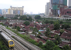 KL Eco City - The northern half of Kampung Haji Abdullah Hukum (as of August 2007), as seen from the Abdullah Hukum LRT station and with the incomplete Gardens shopping centre to the right. By 2008, much of the village was cleared away for a further expansion of the Mid Valley City development project.