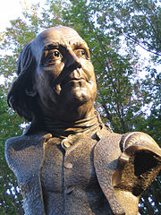 Keys To Community (2007) by James Peniston in Philadelphia, Pennsylvania, is a bust of Benjamin Franklin that is textured with casts of keys, putting a modern twist on traditional figurative sculpture. 39°57′09″N 75°08′47″W / 39.952414, -75.146301