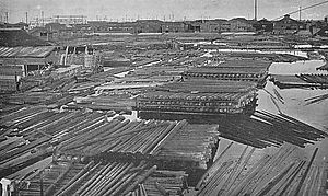 Japan, Our Homeland - Floating timber amassed in Kiba, in the year 1933. In the 1956 of the film, part of the timber still remains.
