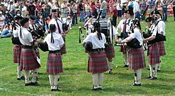 Pipe band in competition at the Skagit Valley (WA) Highland Games. Their kilts are pleated in what is known as military pleating, a style used by many pipe bands.