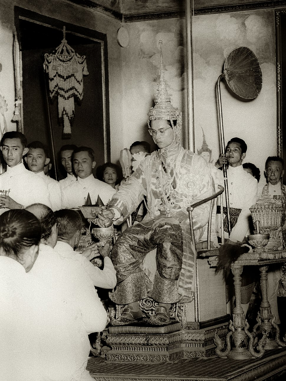 King Rama IX being presented with regalia at coronation