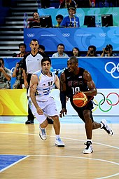 Kobe Bryant drives past a defender at the Olympics Game