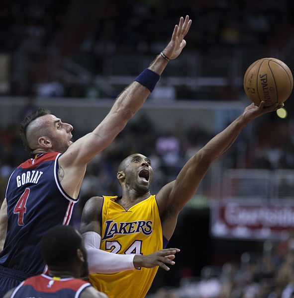 "Kobe Bryant of the Los Angeles Lakers shooting against Marcin Gortat of the Washington Wizards. | Photo from ""Kobe Bryant vs Marcin Gortat"" by Keith Allison, Wikimedia Commons is licensed under CC BY-SA 2.0"