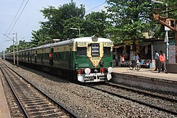 A local train at the Hridaypur Railway Station