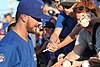 Kris Bryant signing autographs during his rehab assignment against Omaha (29379035217).jpg