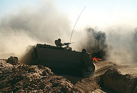 Kuwaiti M113 APC crossing a trench during Operation Desert Shield.JPEG