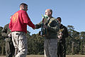 Lieutenant Colonel David E. Moore (left), Commanding Officer, Financial Management School (FMS), Marine Corps Combat Service Support Schools (MCCSSS), accepts the first place trophy for FMS from Colonel Paul 131025-M-GJ479-003.jpg