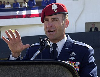 United States military beret flash - A US Air Force colonel wearing his scarlet beret with metal flash and miniature rank insignia, which is worn by US Air Force Special Tactics Officers and Combat Controllers.