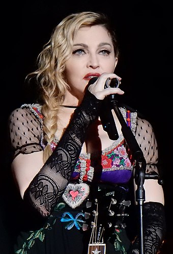 "American singer Madonna has been dubbed the ""Queen of Pop"". Madonna Rebel Heart Tour 2015 - Stockholm (23051472299) (cropped).jpg"