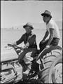 Manzanar Relocation Center, Manzanar, California. H. Kawase, 20 (left), and M. Sakai, 22, operate t . . . - NARA - 538480.tif