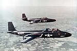 McDonnell F2H-4 and a F2H-2P Banshee in flight near St. Louis, Missouri (USA), circa in 1953 (NNAM.1996.253.7249.046).jpg