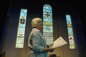 Napier Waller - Stained glass historian Dr Bronwyn Hughes inspects the Napier Waller windows in The Armidale School's War Memorial Assembly Hall