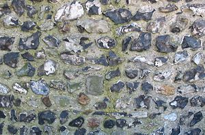 Merton Priory - Remains of a knapped flint wall, a rare survival from Merton Priory