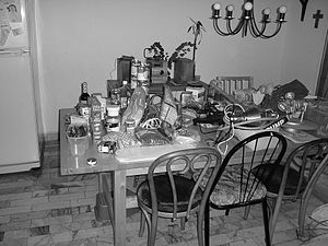 Photo of a dining room table piled with objects