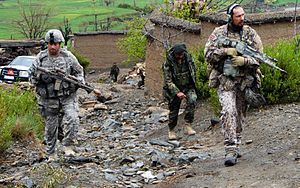Latvian Land Forces - Latvian, US, and Afghan soldiers on patrol in Afghanistan.