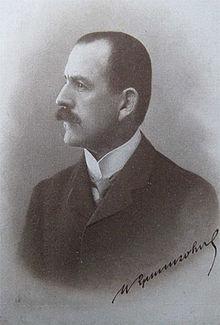 zwart-witfoto van een mannetje in formele kledij