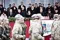 Ministru prezidents Valdis Dombrovskis vēro Nacionālo bruņoto spēku vienību militāro parādi 11.novembra krastmalā (6357914153).jpg