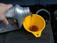 Motor oil refill with funnel.JPG