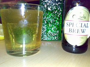 Beer cocktail - A shot glass containing Midori was dropped into a glass of shandy, making a fairly potent beer cocktail.
