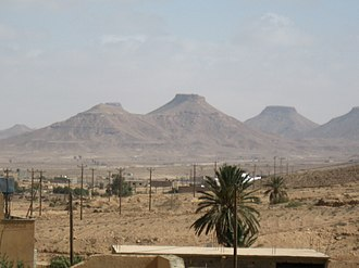 Wazzin - Wazzin in the desert, with Nafusa Mountains.