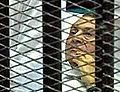 Mubark behind the bars.JPG