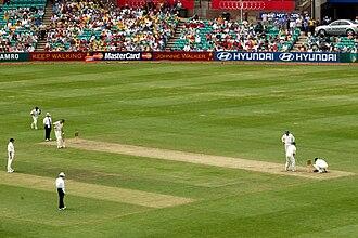 Muttiah Muralitharan - Muttiah Muralitharan bowling in SCG for ICC World XI