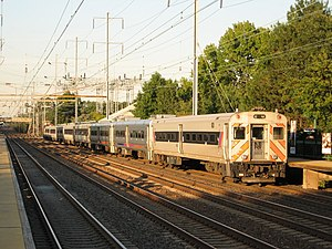 Comet (railcar) - A New Jersey Transit consist with a Comet III cab, followed by several Comet Vs and Comet IIMs, with a Comet IV closest to the engine