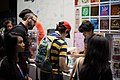 Ness making a purchase at PAX Prime 2012 (7911917762) (2).jpg
