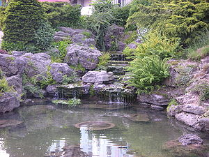 Formal rock garden pond with waterfall.