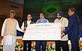 Nitin Gadkari receiving the bonus shares from the CMD of WAPCOS Ltd., Shri R.K. Gupta, at a function, in New Delhi.jpg